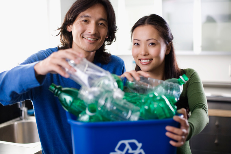 Two people recycling
